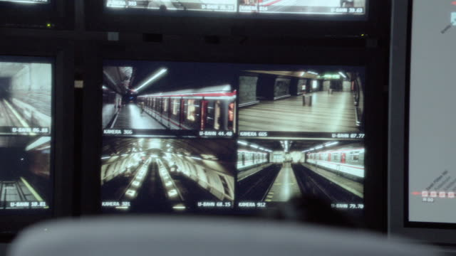 pan control room screen displaying a traffic map tracking the real-time movement of trains, along with multiple images of surveillance at a train station - railway station stock videos and b-roll footage