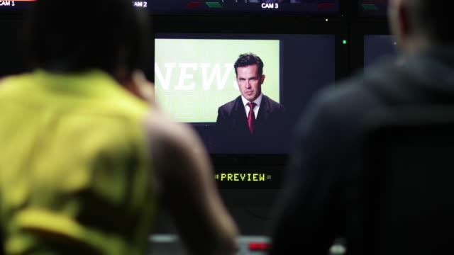 Control room speaking to presenter in TV studio