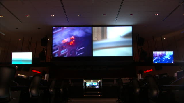 control room surveillance screens monitor activity in new york city. - control room stock videos & royalty-free footage