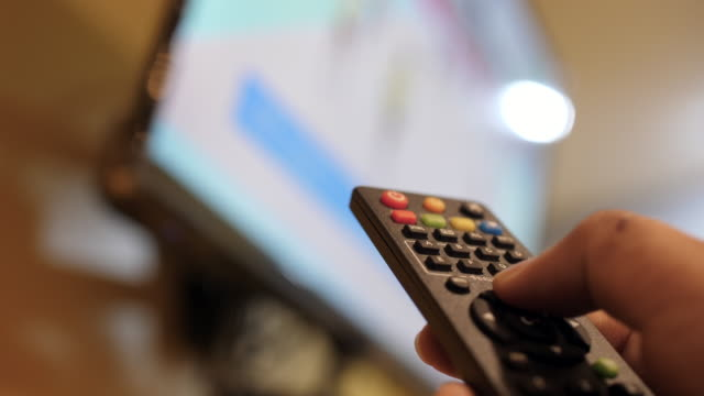 control television by remote control - flat screen stock videos & royalty-free footage