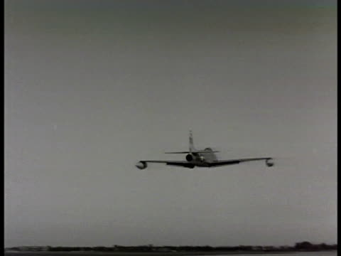stockvideo's en b-roll-footage met control tower int tower air traffic controller clearing jets for takeoff tracking p80 shooting star jet taking off jets taking off in pairs jets in... - 1948