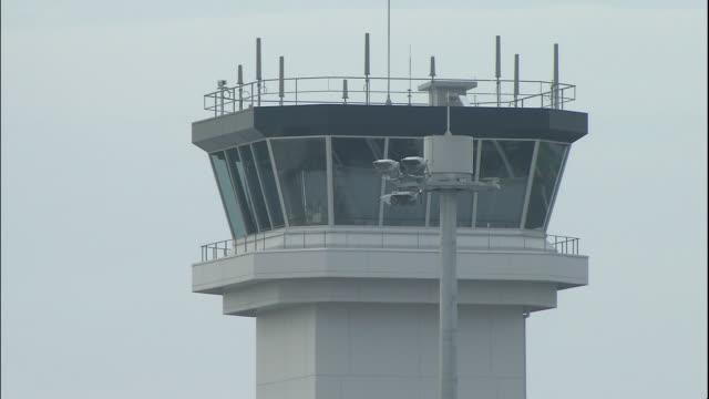 a control tower overlooks the mt. fuji shizuoka airport in makinohara, japan. - shizuoka prefecture stock videos and b-roll footage