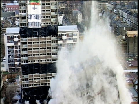 controlled demolition of two tower blocks in east london - imploding stock videos and b-roll footage