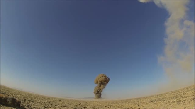 stockvideo's en b-roll-footage met controlled detonations by air force explosive ordinance disposal technicians assigned to the 466th air expeditionary squadron kandahar, afghanistan... - operation enduring freedom
