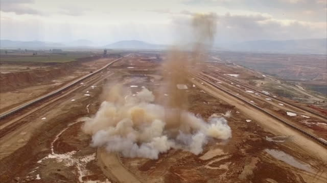 controlled explosion at open pit coal mine, greece - quarry stock videos & royalty-free footage