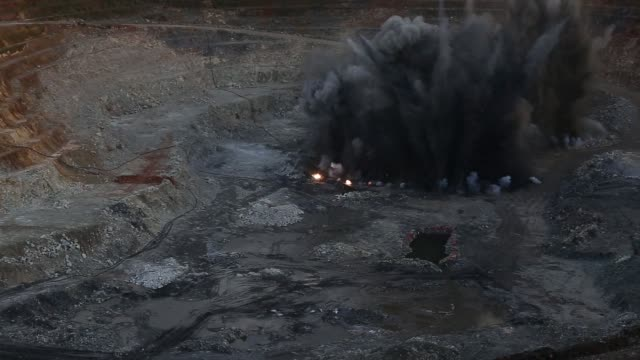a controlled explosion in the pit at the kibali gold mine operated by randgold resources ltd in kibali democratic republic of congo on friday oct 17... - mine stock videos & royalty-free footage