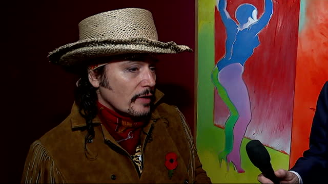 Controversial pop artist Allen Jones opens show at Royal Academy Silhouette of Adam Ant in front of artwork on gallery wall Adam Ant and reporter...