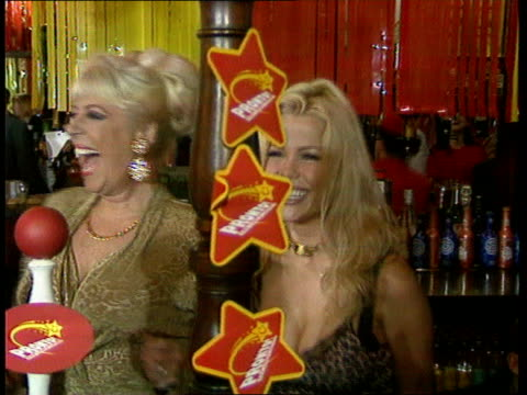 vídeos de stock, filmes e b-roll de controversial pub lottery game launched ac4n london int julie goodyear and models pulling beer pumps in pub at launch of pronto lottery game large... - jogo da sorte