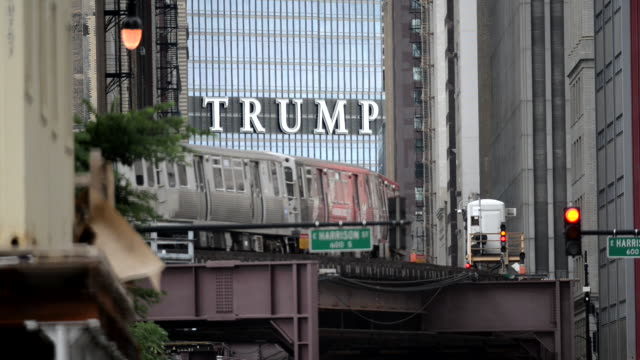 a controversial sign constructed of twenty foot high letters spelling trump on the 92 story trump tower looms over pedestrian and vehicle traffic on... - spelling stock videos & royalty-free footage