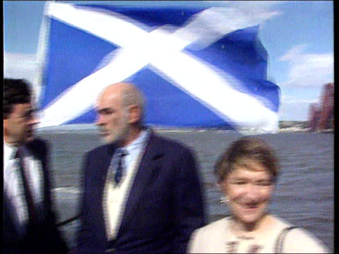 controversy around nomination of knighthood for sean connery; tx 7.9.97 scotland: firth of forth: ext gvs sean connery standing on boat beside gordon... - sean connery stock videos & royalty-free footage