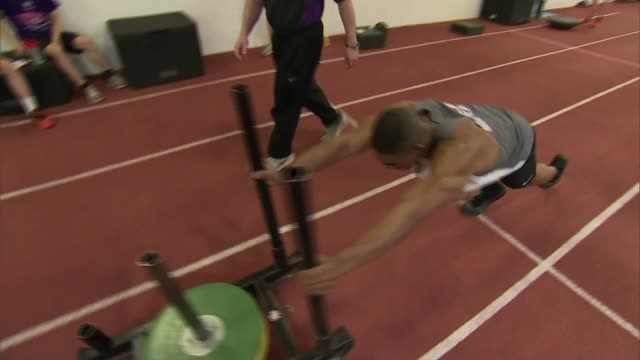 Controversy over Team GB 'aerodynamic' suits ENGLAND Loughborough University INT Athlete pushing weights along indoor track during training / Dr...