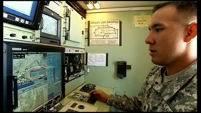 controversy over us drone attacks in pakistan and yemen 762010 / t07061022 arizona army drone pilot in control room monitoring footage on screen - drone pilot stock videos and b-roll footage