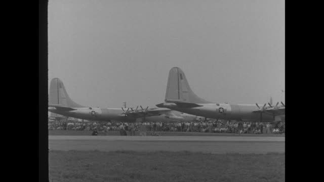 ms convair yb60 bomber jet moves on carswell field moving away from camera / ws yb60 turns faces camera / crowds surround the yb60 and another plane... - bomber plane stock videos and b-roll footage