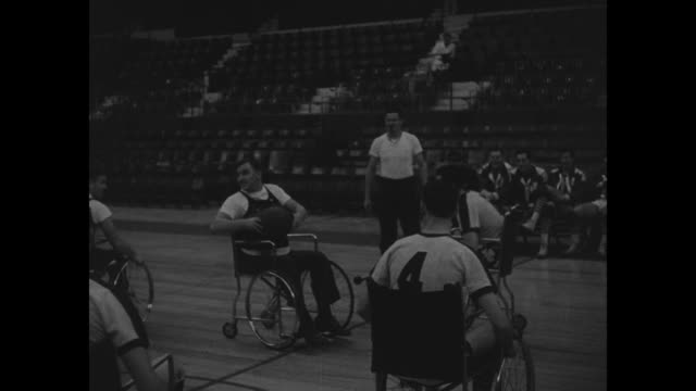 convalescent wwii vets in wheelchairs sit opposite boston celtics / game tip off with both teams in wheelchairs / as game progresses vets block shots... - wheelchair basketball stock videos & royalty-free footage
