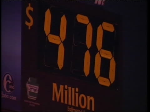 convenience stores were packed with people all wanting to get their hands on a mega millions lotto ticket. the record-breaking mega millions jackpot... - maryland us state stock videos & royalty-free footage