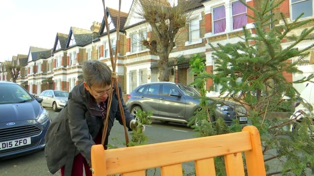 conversion of parking spaces into parklets backed by hackney council; uk, hackney; parklets, rita krishna interview. england: london: hackney: ext... - secateurs stock videos & royalty-free footage