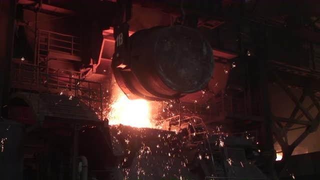 ws  converter putting raw in furnace  / mulheim, north rhine- westphalia, germany - furnace stock videos & royalty-free footage