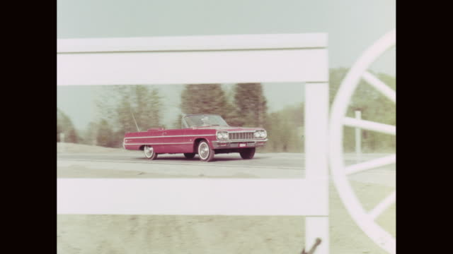ws pan convertible car moving on road / united states - 1964 stock videos and b-roll footage