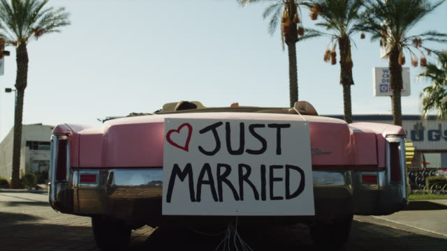 ms ws convertible car with 'just married' sign on rear driving off / las vegas,nevada,usa - placard stock videos & royalty-free footage