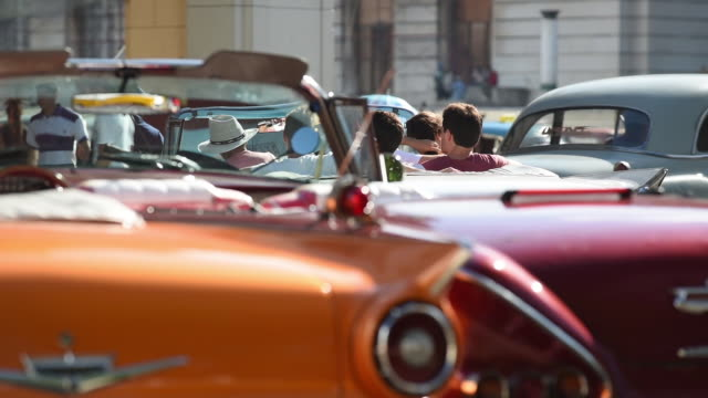 convertible car with passengers in cuba - cuba stock videos and b-roll footage