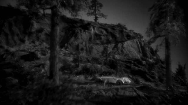 a convertible drives over a cliff, overturns several times and lands right side up at the bottom. - 1934 stock videos & royalty-free footage