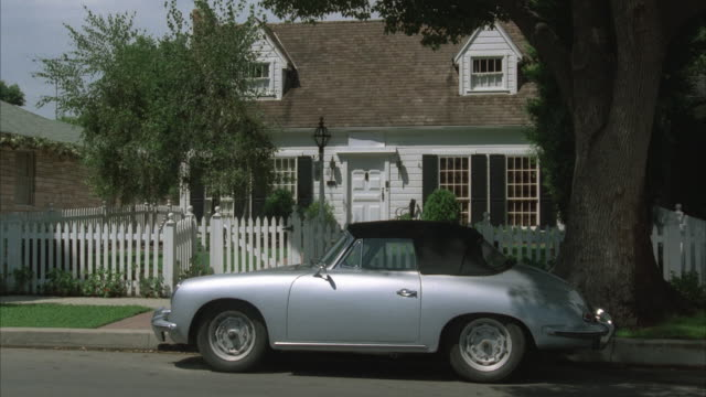 ms, convertible porsche parked in front of house with picked fence - retro convertible stock videos & royalty-free footage