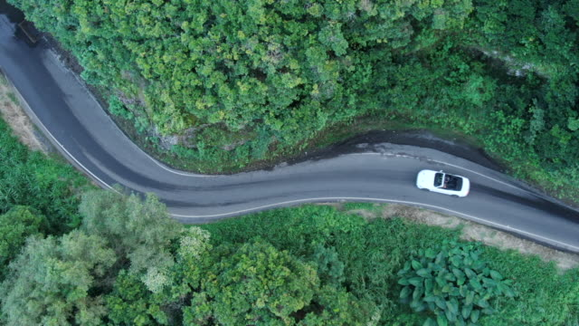 convertible vehicle follows windy mountain road - convertible overhead stock videos & royalty-free footage