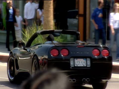 convertible with top down turns left at junction beverly hills - 2000s style stock videos & royalty-free footage