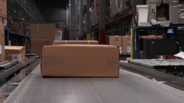 conveyer belt with boxes in a warehouse - conveyor belt stock videos & royalty-free footage