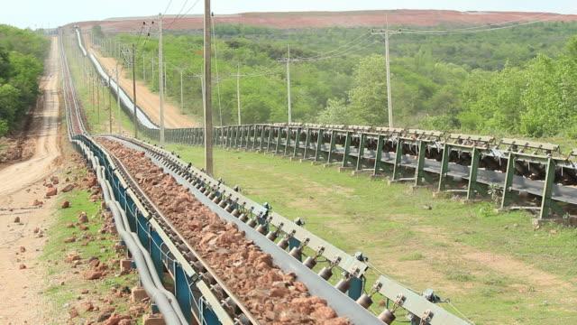 conveyor at work. - conveyor belt stock videos & royalty-free footage