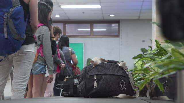 conveyor belt at baggage claim. manila ninoy aquino international airport - baggage claim stock videos and b-roll footage