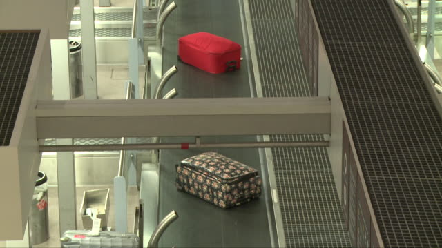 conveyor belt at check-in counter at airport with two baggage items. cape town international airport is located in cape town, south africa and is the... - airport check in counter stock videos & royalty-free footage
