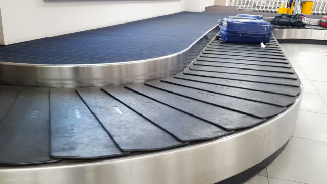 conveyor belt in arrivals lounge at the airport - checked pattern stock videos & royalty-free footage