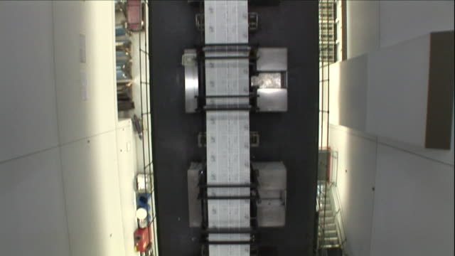 a conveyor belt moves rapidly down below. - pamphlet stock videos & royalty-free footage