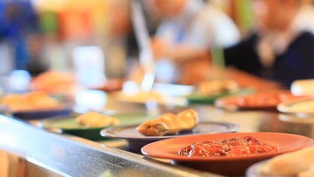 conveyor belt of sukiyaki. - sukiyaki stock videos and b-roll footage