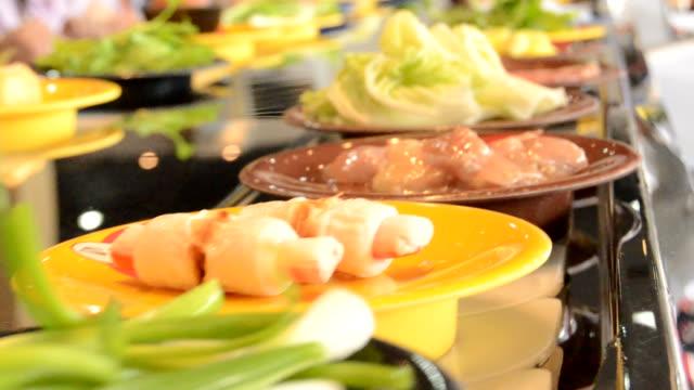 conveyor belt of sukiyaki - sukiyaki stock videos and b-roll footage