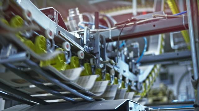 ld conveyor belt releasing the freshly printed newspapers - conveyor belt stock videos & royalty-free footage