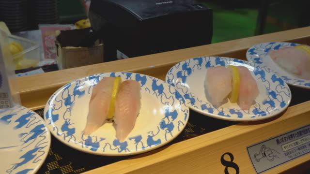 conveyor belt rotated sushi, niigata, japan - shrimp seafood stock videos & royalty-free footage