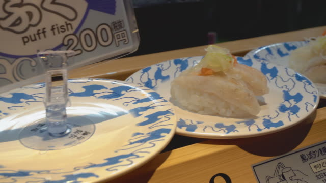 conveyor belt rotated sushi - shrimp seafood stock videos & royalty-free footage