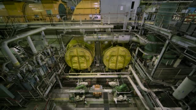 a conveyor belt stands idle at the hazelwood coalfired power plant in hazelwood australia on thursday march 30 steam billows from the cooling stacks... - lever stock videos & royalty-free footage