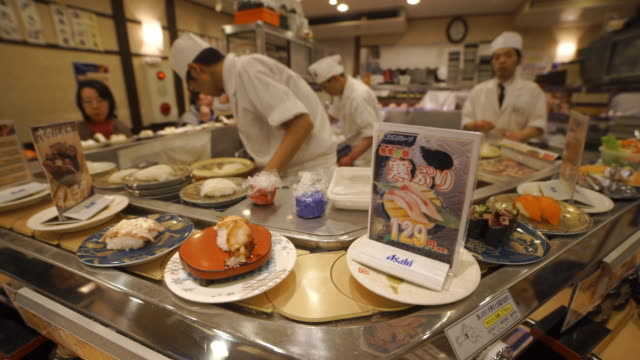 conveyor belt sushi restaurant - japan - japan stock videos & royalty-free footage