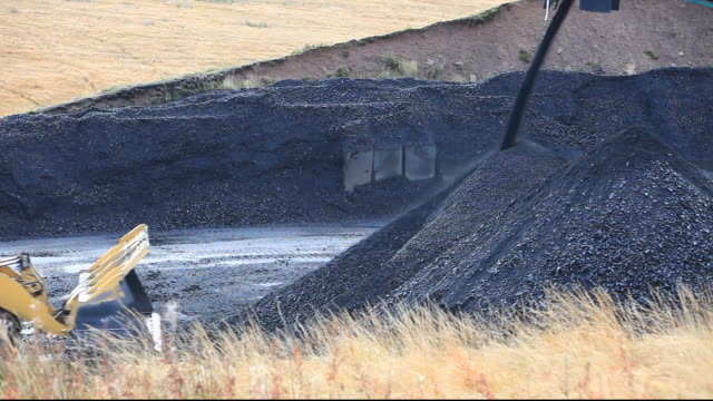 a conveyor belt that takes coal from the glentaggart open cast coal mine to a road head for onward transport by road in lanarkshire, scotland, uk. as well as the disastrous climate change consequences of continuing to mine and burn coal, living close to op - hypertension stock videos and b-roll footage