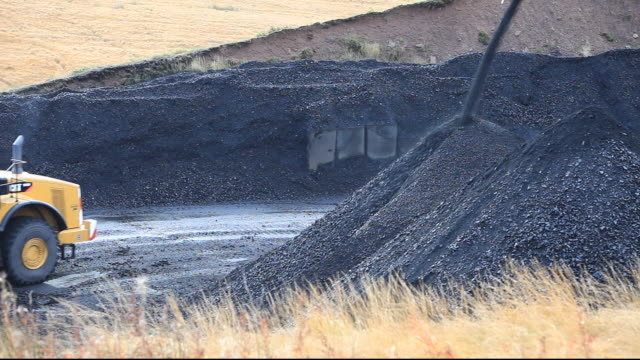 A conveyor belt that takes coal from the Glentaggart open cast coal mine to a road head for onward transport by road in Lanarkshire, Scotland, UK. As well as the disastrous climate change consequences of continuing to mine and burn coal, living close to op