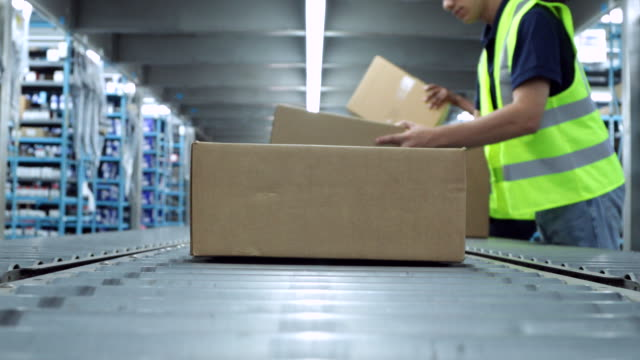 conveyor belt with boxes - distribution warehouse stock videos & royalty-free footage