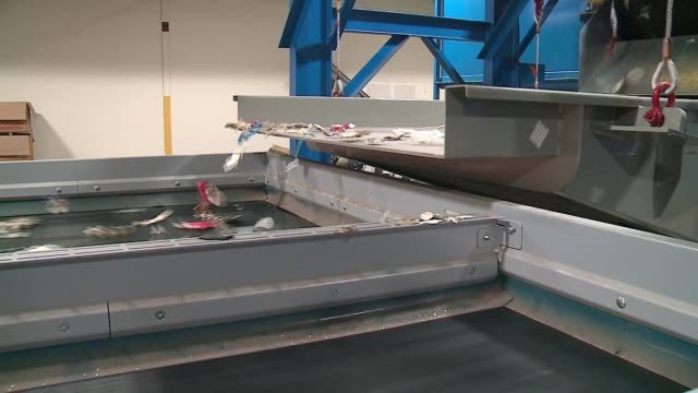 conveyor belts move along plastic and styrofoam in plastic recycling inc. at indianapolis on oct. 6, 2016. - ポリスチレン点の映像素材/bロール