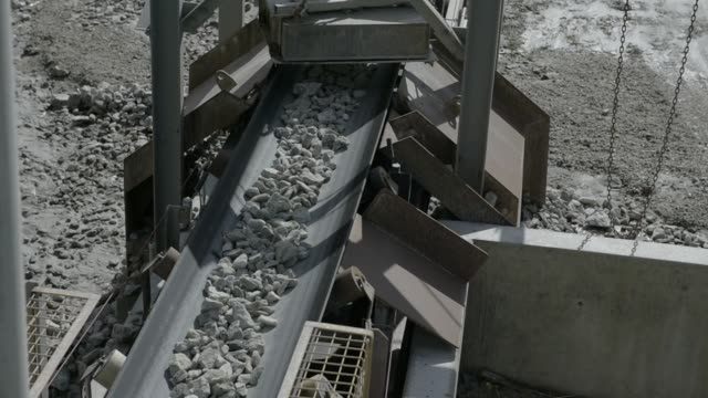 A conveyor loads lithium ore onto a stockpile at a Talison Lithium Ltd facility a joint venture between Tianqi Lithium Corp and Albemarle Corp in...
