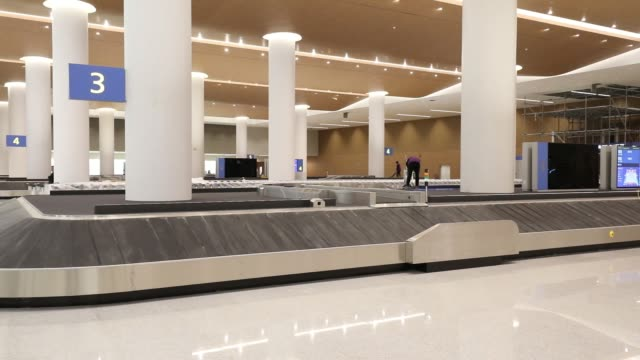 stockvideo's en b-roll-footage met conveyors are seen in the baggage reclaim hall inside the nearly completed terminal 2 building during a media preview at incheon international... - incheon
