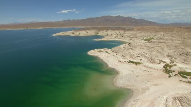 a convoluted desert shoreline characterizes nevada's lake mead. - lake mead video stock e b–roll