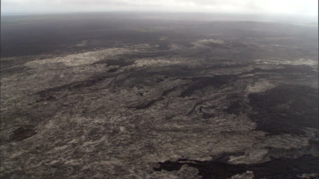 convoluted terrain occupies the interior of a volcano caldera. - terra brulla video stock e b–roll