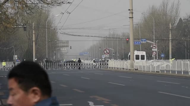 A convoy is seen on the road as Beijing tightens security with speculation rife that North Korean leader Kim Jong Un is making a surprise visit after...